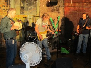 Randy Crouch tearin' it up at The Brick with David Amram and Don on bass - Dean is hiding back there on the drums.